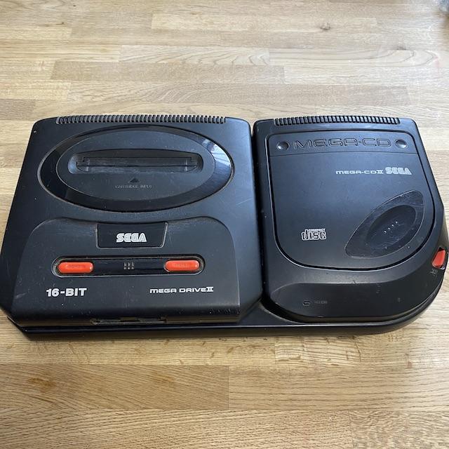 Sega Mega cd model 2 console paired with the mega drive model 2